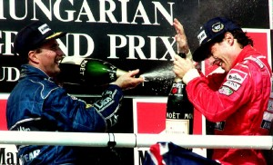 Mansell sprays Senna with champagne